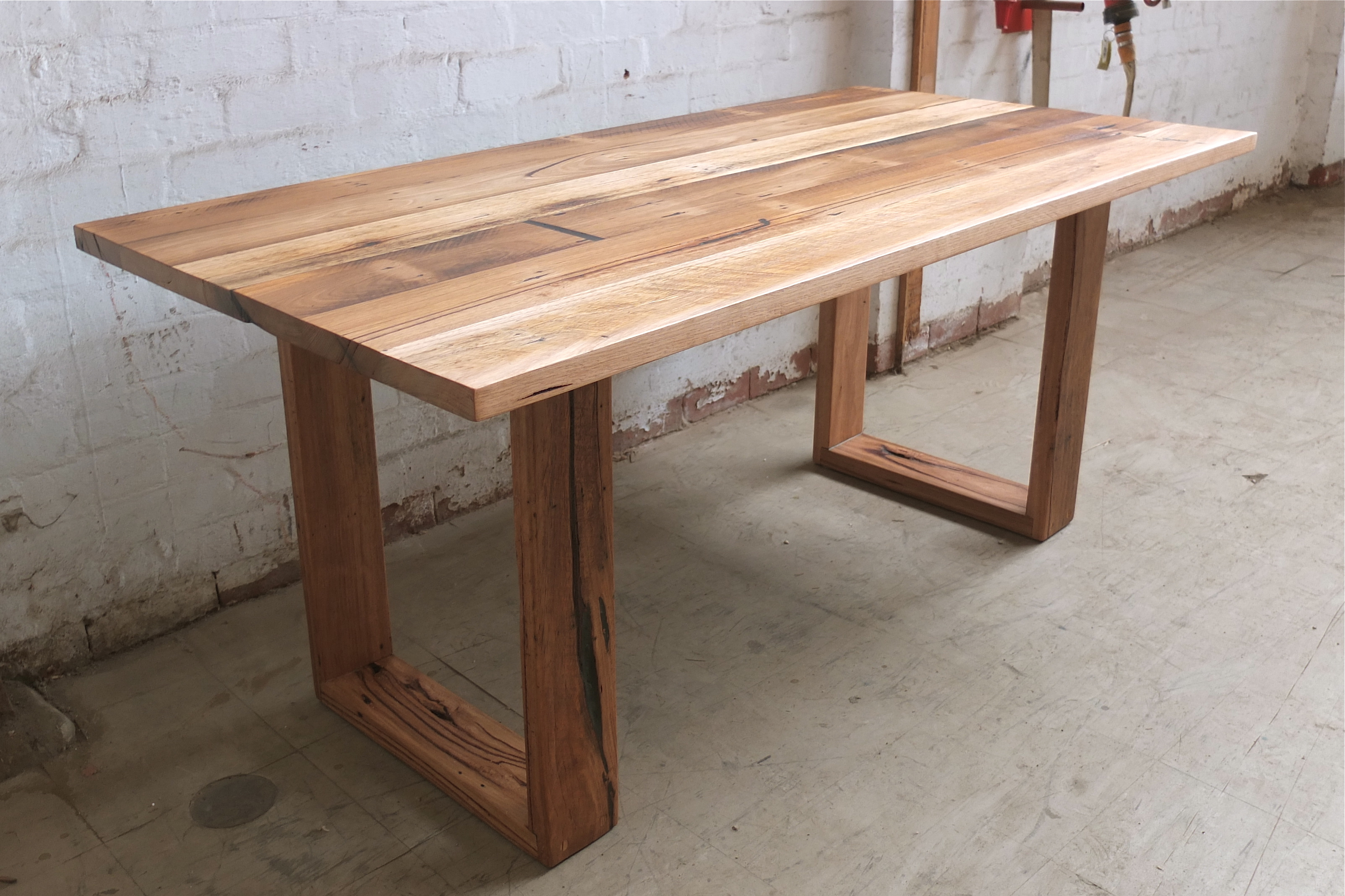 Recycled timber tables tim t design for Hardwood dining table