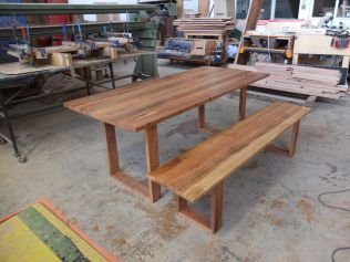 Reclaimed hardwood table and bench